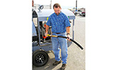 A user displaying the HandiFueler Ground Support Fuel Service Cart (AGE Refueler)'s flex defuel wand,