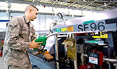 An USAF airman inspecting a HandiFueler Ground Support Fuel Service Cart (AGE Refueler) before it's put into daily service.