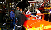 Personnel from FedEx LAX learning how to use a SealVac vacuum fuel drain bowser