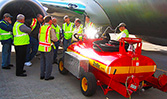A group of Boeing 737 maintenance techs training on SealVac bowser use at Boeing Renton